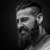 A strong face (JP Defay) Tags: rittratto portrait portraiture oldtimer people noir homme lowkey photos monochrome man beard barbe barbu bearded fondnoir blackandwhite noiretblanc