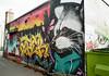 Handsome Trash Panda (Georgie_grrl) Tags: graffitijauntwithjan graffiti streetart expression creative colourful pentaxk1000 rikenon12828mm alleyway toronto ontario raccoon trashpanda hoodie handsome tagging font powerpuffgirl buttercup cityscape ratzillasilhouette