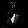 praying god brings me through these dark times. (Anthony. B) Tags: nikon d3100 lowkey lowkeyphotography shadow dark night highlights portrait guy man yankee hat silhouette 55200mm