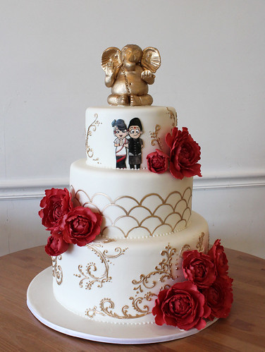 Gold Buddhist Elephant and Scrollwork Wedding Cake