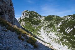 Pod Voglom (Marua erjal) Tags: red mountains alps color green sports grass sport contrast julian rocks hiking peak slovenia summit hiker peaks bohinj alpe vogel slopes summits hribi julijske