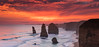 Burning sky at the Apostles (Howard Ferrier) Tags: oceania rock victoria sunset portcampbellnp stacks clouds orange graduatedfilter waves sedimentaryrock southwest limestone cliff australia filter twelveapostles coast lee09hardgrad princetown au painterly cloudsstormssunsetssunrises
