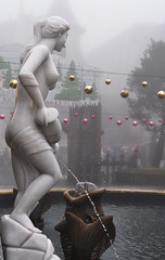 Not what it seems (Roving I) Tags: fog fountains nudity statues fish nakedwomen ponytails waterstreams christmasbaubles mist weather banahills themeparks tourism danang vietnam vertical