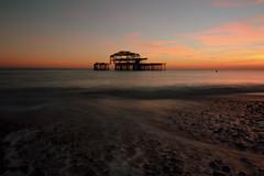 West Pier Sunset (Crisp-13) Tags: brighton east sussex west pier sunset long exposure pebble beach sea tide coast seaside red sky ruin wide angle