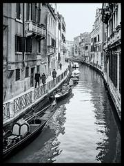 Winter in Venice (Marc Rauw.) Tags: venice canal gondola winter water city italy people peopleinthecity boats boat blackandwhite bw monochrome olympusomdem10 olympus omd em10 microfourthirds m43 μ43 panasoniclumix20mmf17 panasonic lumix f17 street citylife cityscape bridge