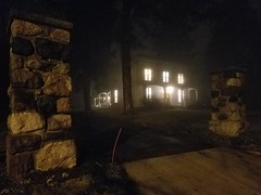 Spooky House in the Fog (niftyc) Tags: outside spooky mansion fog night outdoors haunted woods lights
