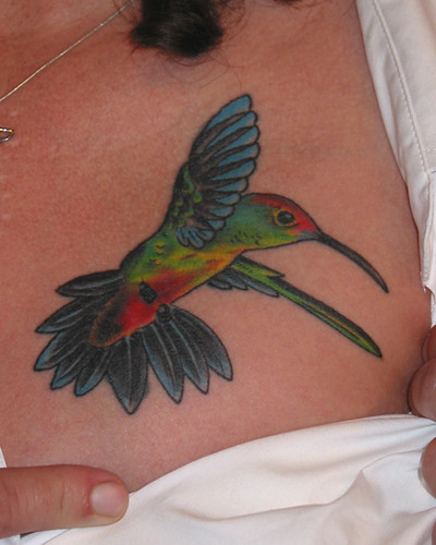 cute colorful hummingbird tattoo design on chest