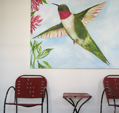 hummer (emdot) Tags: hummingbird notsotiny chairs chair table metal spasanitarium bb embadge bird painting