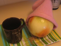 onion pulls on a hat and enjoys a cup of coffee