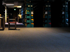 alone with books (emdot) Tags: mystery chair quiet interior library books seating academic embadge libslibs librariesandlibrarians ll100