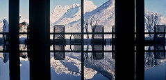 Swiss Alps Reflection - St Johann (SCFiasco) Tags: new travel blue light shadow vacation mountain holiday snow alps color deleteme reflection building window water pool silhouette closeup fun switzerland photo snowman europe deleteme10 swiss wide saveme8 shade hottub serenity repetition serene snowcap stjohann scfiasco siasoco edwinsiasoco edsiasoco