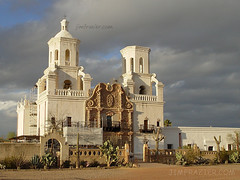 San Xavier del Bac Mission (Jim Frazier) Tags: 2003 lighting travel blue light arizona sky brown building history church architecture clouds buildings scaffolding tucson v100 structures beautifullight cybershot f10 structure historic steeple adobe dome mission scaffold g1 historical americana f3 february underconstruction f5 oldbuilding stucco historicplace historicalbuilding sanxavier f15 v200 stormlight historicbuilding sanxavierdelbacmission interestinglight nationalregisterofhistoricplaces v500 v1000 q4 v2000 explored nrhp interestingness445 nationalregisterofhistoricalplaces jimubs jimfraziercom jfpblog wmembed