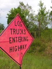 Sign on the Road Where I Live (Old Shoe Woman) Tags: usa georgia southgeorgia dilosep05 trees logtrucks logging sign dilosept05