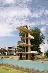 Such great heights (Kalabird) Tags: khmerarchitecturaltours cambodia phnompenh buildings architecture city pool diving children platform