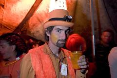 orange tent (lomokev) Tags: party portrait orange man male canon sand 300d desert burningman blackrockcity dust blackrock burningman2005 blackrocksands deletetag file:name=crw4513