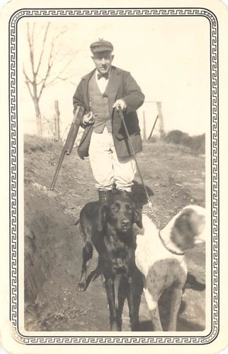 Hunter in a high fashion hunting outfit with dogs by Antique Dog Photos.