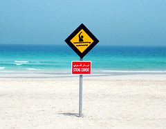 Beach PMSing (Kitten) Tags: jumairah beach dubai jumairah beach dubai sign sign strong current warning