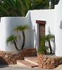 Classy Doorway (Lazy B) Tags: fz5 spain villa door palm light shadow stone white fv5 wonder 510fav topv111 loveit 20topfaves2005