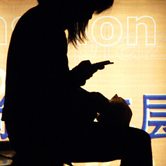 waiting for your sms... (Lumatic) Tags: china travel light shadow portrait people urban woman black girl silhouette yellow topv111 mobile backlight night contrast digital dark handy asian lite photography photo back lowlight women waiting asia flickr darkness shanghai nightshot photos telephone profile young picture cellphone professional explore negative dreams online mobilephone someone positive nightphoto sodium catchy digitalphoto nite vapor sms digitalphotos gegenlicht blackyellowblue smsing photosonline photoonline lumatic