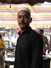 c-o-o-l (uninvolved observer) Tags: 2005 china travel favorite top20portrait market muslim hotan xinjiang silkroad 中国 新疆 g6 uyghur sundaymarket 和田