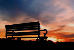 Take a Seat and Admire the View... (Trapac) Tags: blue autumn sunset red england sky orange silhouette yellow clouds bench downs bristol geotagged gold thedowns durdhamdown bristoldowns explored savedbythedmusunscapegroup flickl geo:lat=51471252 geo:lon=2625947 flickrcollectionongetty
