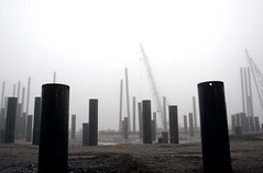 Ghost Pilings (Bhlubarber) Tags: ocean silhouette vancouver 1025fav construction industrial crane 400views 300views 200views pilings vancouverfog davidniddrie