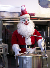 Come Here My Little Pretty.  Want To Be Part of Santa's Christmas Stew? (Sister72) Tags: daystillchristmas santa clown decorations asburypark nj scary creepy santaclaus red costume throughawindow 2005 sister72 monmouthcountynj beard gloves reflection xmas givesmethecreeps