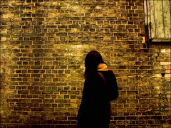 . Loneliness . (3amfromkyoto) Tags: door wood uk cambridge england woman black brick wall scarf hair wooden alone loneliness misako coat bricks atmosphere scene sombre kanji lane strap isolation lonely calligraphy solitary kodoku 3amfromkyoto flickr:user=3amfromkyoto