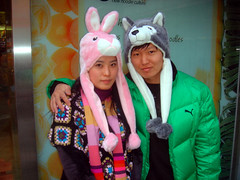 cute animal xmas couplelook, Edae (superlocal) Tags: pink people dog cute rabbit green girl hat animal puppy design cool funny couple university korea womens photoblog korean novelty seoul trend hip photolog greencoat icn edae february2006 couplelook ewhawomensuniversity ricohgrd superlocal seoulphotoblog