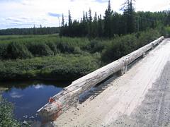 Northern Ontario 08.17.2005 (JohnSax) Tags: road bridge trees ontario river dirt northern wodden