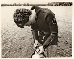 Adjusting the regulator (Reigh LeBlanc) Tags: lake ontario canada wet water vintage outside tank waterfront cottage scuba diving suit 70s late wetsuit regulator neoprene