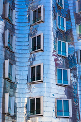 metallic house with blue windows, modern architecture (Armin Staudt) Tags: new blue light summer sky sun house abstract reflection building home window beautiful wall architecture modern facade germany season concrete outside outdoors design office construction technology exterior view bright metallic background empty perspective property style nobody gehry structure clear business housing concept luxury