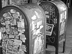 Mailboxes (ETL-Photography) Tags: street city white black art mailbox photography graffiti store sticker downtown mail box tag stickers sidewalk vandalism boxes slap grayscale stores maiboxes slaptag
