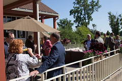 Chamber members enjoy the relaxed atmosphere of the TPC Michigan golf club in Dearborn during July's Connections & Cocktails event.