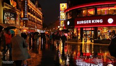 Midnight rain in Leicester Square (Patrizia Ilaria Sechi) Tags: uk nightphotography england london night reflections colorful vibrant entertainment neonlights leicestersquare nocturne urbanphotography richcolors urbannights lowlightphotography vuecinema londonintherain magicalrain citiesintherain hippodromecasino vibrantatmosphere burgerkingbuilding rainynightinleicestersquare
