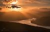 Loch Katrine Sunset (GenerationX) Tags: sunset orange mountains water silhouette clouds landscape evening scotland nationalpark unitedkingdom dusk scottish peak neil gb summit prints rays trossachs barr gloaming strathgartney benvenue lochkatrine stronachlachar beinnchabhair kinlochard beinnachroin ancaisteal stobachoin cruinnbheinn canon6d rubhanamoine meallnaboineide rubhanammult angaradh stobanduibhe
