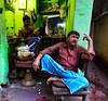 Barbershop, Kolkata (paola ambrosecchia) Tags: barbershop kolkata india asia streetphotography colors street face portrait people amazing beautiful fujifilm fuji travel travelphotography walking trip night light city wow