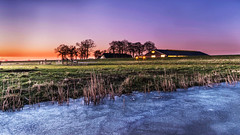 Farm at sunset (Kjeldvdh) Tags: landscape landschaft nederland netherlands niederlände amersfoort utrecht eem soest ice frozen eis kalt cold colourful grass water pond vries pink purple yellow blue green blau gelb grün violet violett scenery bauernhof farm boerderij sun weiland field sunset sonnenuntergang watter zonsondergang reed plant winter serene nature creek dike hill m mood sky evening abend luft dawn long exposure hour flickr farbig color ambient nikon d5500 wide angle scene low house barn trees tree home planze baum