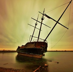 You will always be beautiful (Andre Dillon) Tags: boat old mass lake water abandoned ship sail sky clouds toronto