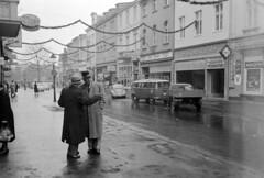 AE013a (Grudnick) Tags: damp december deutschland negative eastman13 35mm zeisscontax rangefinder bonn germany bw film men hats longcoat rain wet vw