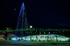 Festive atmosphere (anton_frolov) Tags: night outdoor skyline lights rink university skating lamppost christmastree newyear moon russia tomsk sony a65 winter snow