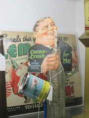 The Taste that Refreshes - Liquid Chocolate Cocoa Crush 0465 (Brechtbug) Tags: the taste that refreshes liquid chocolate cocoa crush cardboard standee ad billboard advertisement 01212017 new york city billboards poster shadows afternoon soda soft drink straw diet can bottle glass milky milk smiling winking man sidney greenstreet type guy 1930s straws sipping