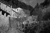 architecture, stone walls, ravine, fence, bridge, LeCelle, Cortona, Tuscany, Italy, Nikon D40, Sigma 18-50mm EX DC MACRO, 12.30.16 (steve aimone) Tags: architecture architecturalforms stone stonesurfaces stonewalls fence bridge ravine lecelle sanctuary lecellesanctuary cortona tuscany toscana italy nikond40 sigma1850mmexdcmacro landscape monochrome monochromatic blackandwhite