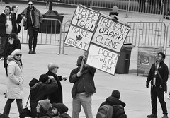 a lone Trump supporter at Nathan Phillips Square (mcfcrandall) Tags: march protest obama trump trudeau man woman politics nathanphillipssquare toronto photography