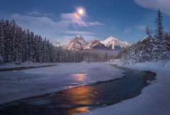Golden silence ( Explored ) (Sapna Reddy Photography) Tags: nature landscape nationalpark alberta night curve flow river ice water snow winter moonlight moon mountains mountain rockies canadianrockies canada banff