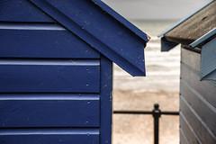 Beach Huts Fence (pogmomadra) Tags: uk sea beach fence coast seaside bokeh norfolk huts friday fenced mundesley hff fench happyfencefriday nikond5300