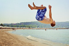 Sani 038 (EllieMooSmith) Tags: boy sea sky holiday man green beach canon fun sand surf greece flip gymnastics sani backflip trampolining canon550d