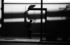 A figure emerges (p r a t y u s h 360 | PHOTO) Tags: dark blackandwhite monochrome canon5d3 canon135l young man outdoor street streetphotography shadow