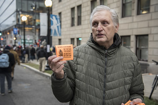 Martin Gugino Distributes Witness Against Torture Flyers Outside the Presidential Inauguration of Donald Trump