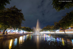 Like St. Valentine (Swebbatron) Tags: asia southeastasia thailand chiangmai city moad urban night dusk longexposure reflection fountain traffictrail canon radlab gettotallyrad 1018mm trees lifeofswebb 2015 lonelyplanet